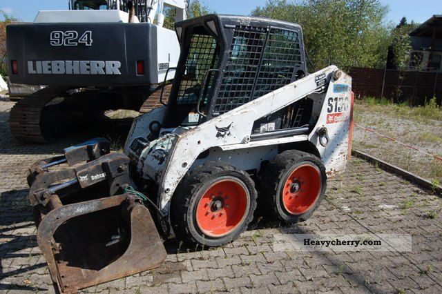 2007 Bobcat  S130 with combination blade u hydr.Industriegreifer Construction machine Mini/Kompact-digger photo
