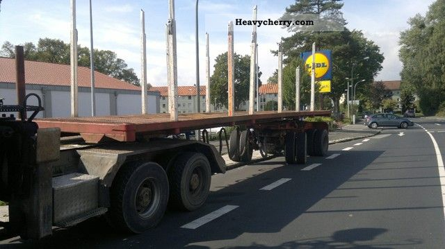 1980 Doll  2.DS Nachleufer with 20 bridge and 12 Schtange Semi-trailer Timber carrier photo