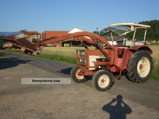 2011 Case  553 with front loader Agricultural vehicle Tractor photo