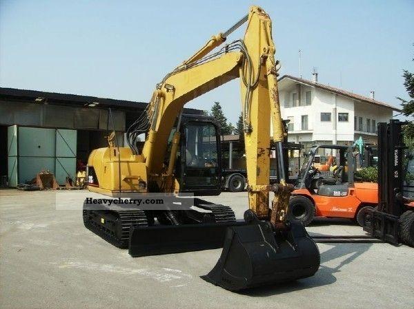 2011 CAT  Caterpillar 311CU Construction machine Combined Dredger Loader photo