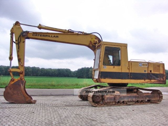 1985 CAT  215 Construction machine Caterpillar digger photo