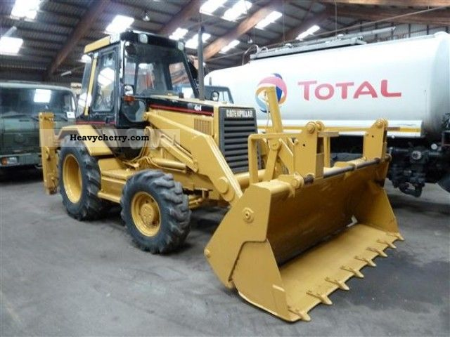 1995 CAT  428 B Construction machine Combined Dredger Loader photo