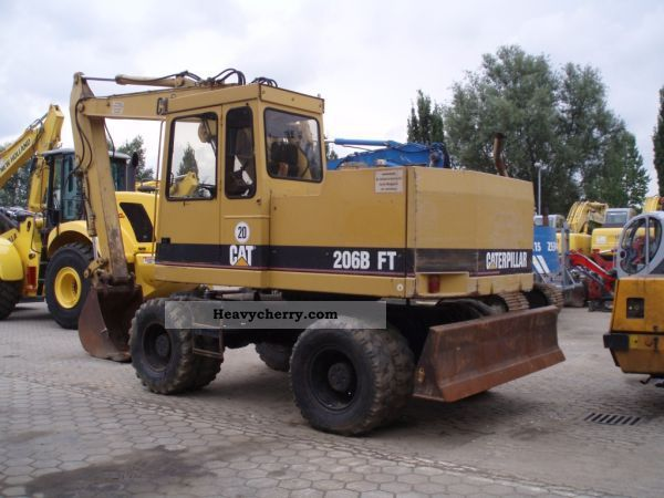2011 CAT  206B FT Construction machine Mobile digger photo