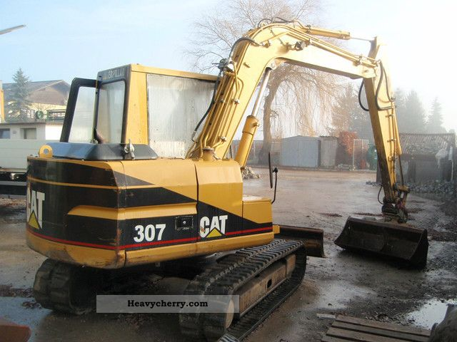 cat 307 1998 caterpillar digger construction equipment photo and specs. Black Bedroom Furniture Sets. Home Design Ideas