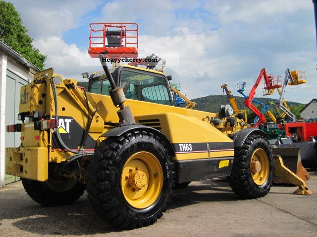 1996 CAT  Caterpillar TH63 TURBO 4x4x4 / auxiliary hydraulic Forklift truck Rough-terrain forklift truck photo