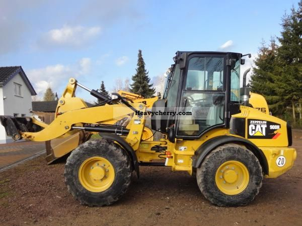 2010 CAT  908 H-dumping bucket Construction machine Wheeled loader photo
