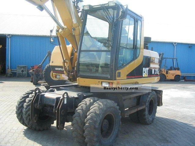 2002 CAT  M315 Construction machine Mobile digger photo