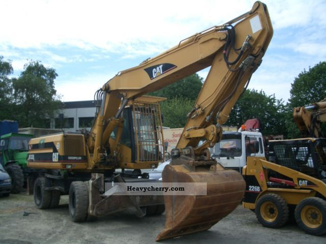 2001 CAT  M 320 climate! Construction machine Mobile digger photo