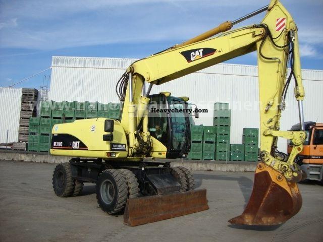 2004 CAT  M 318C M318C hydraulic shield climate SW Vollverrohrun Construction machine Mobile digger photo