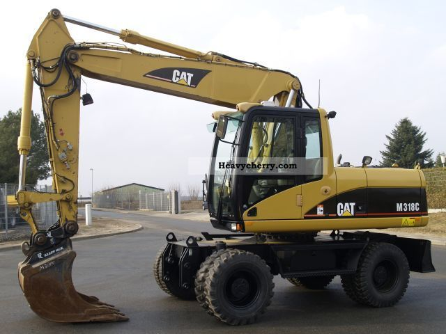 2004 CAT  M 318 C - SPEED 34 km / h Construction machine Mobile digger photo