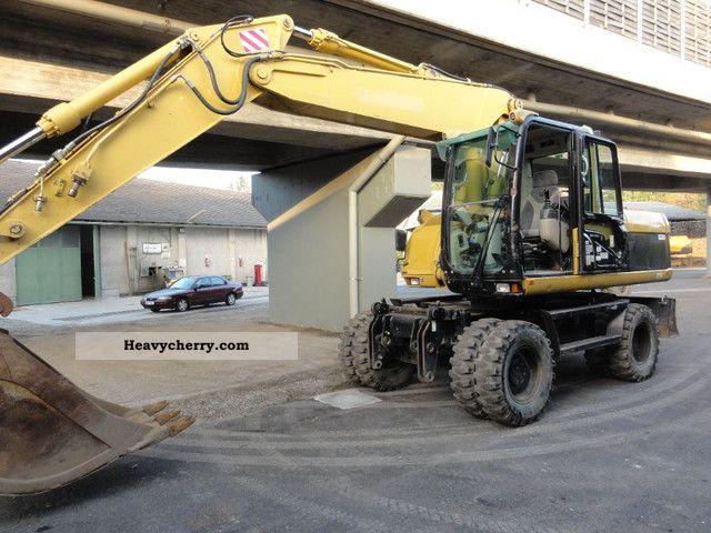 2003 CAT  M 318 C Construction machine Mobile digger photo