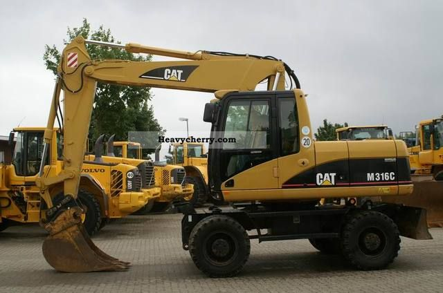 2005 CAT  M 316 C - shield, hydr. Boom, AirCo, SW Construction machine Mobile digger photo