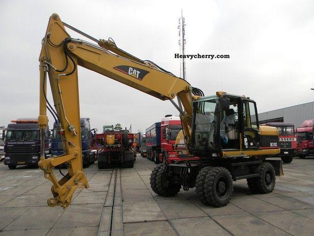 2006 CAT  catepillar M318C TOPZUSTAND Construction machine Mobile digger photo