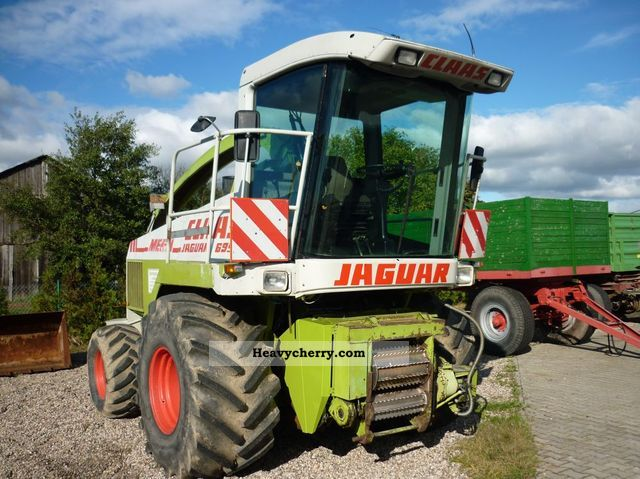 1993 Claas  695 MEGA Agricultural vehicle Reaper photo