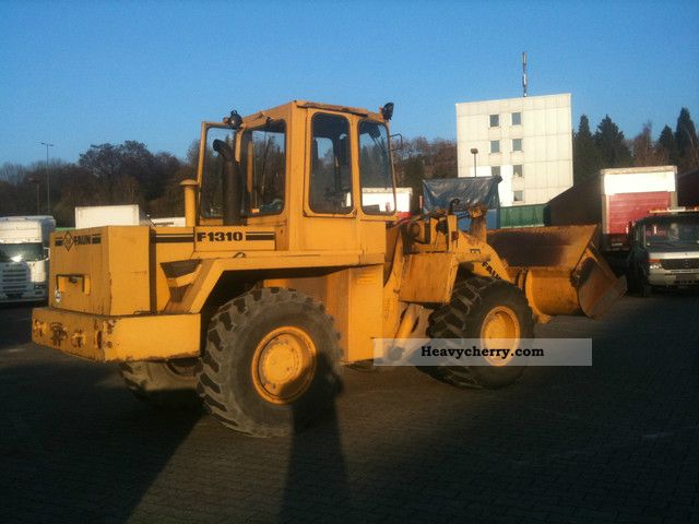 1988 Faun  F13010 with built-in scale Construction machine Wheeled loader photo