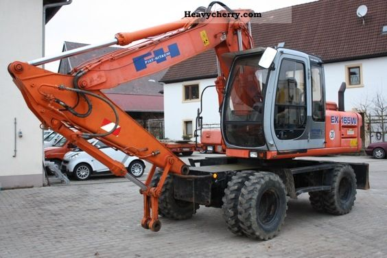 1999 Hitachi  EX 165 W Construction machine Mobile digger photo