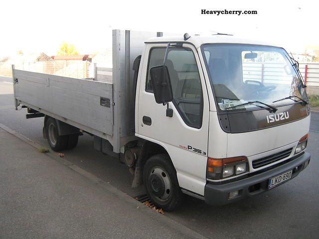 Isuzu NPR 77 2004 Stake body Truck Photo and Specs