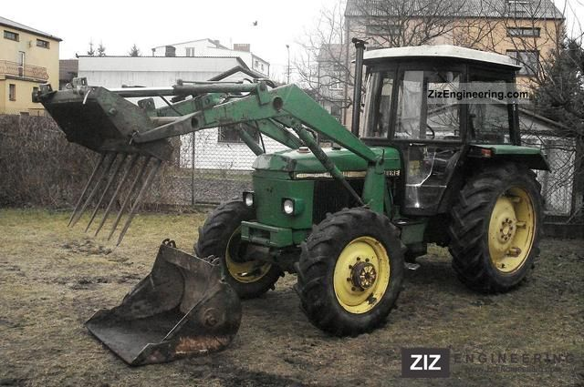 1985 John Deere  1640 4x4 with FRONTLADER 1985r. Agricultural vehicle Tractor photo