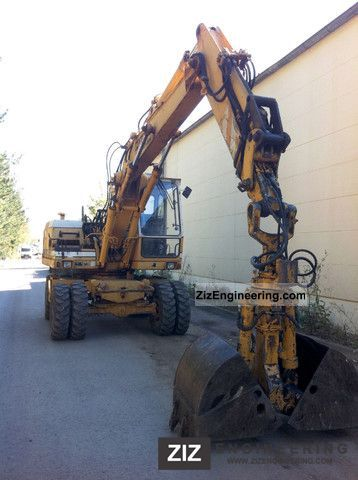 1990 Liebherr  902 16t excavator wheel gripper Construction machine Mobile digger photo