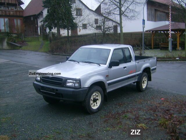 mazda b2500 1998 stake body truck photo and specs. Black Bedroom Furniture Sets. Home Design Ideas
