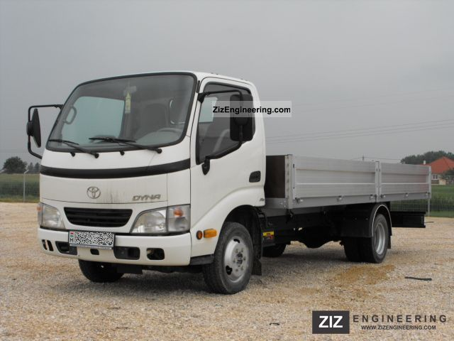 2003 Toyota  Dyna 150 with flatbed and canvas Van or truck up to 7.5t Stake body and tarpaulin photo