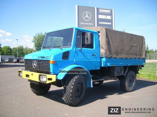 unimog u 1300 l 1994 stake body and tarpaulin truck photo. Black Bedroom Furniture Sets. Home Design Ideas