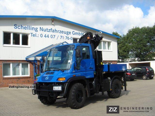 2003 Unimog  U 300 with MKG crane Truck over 7.5t Stake body photo