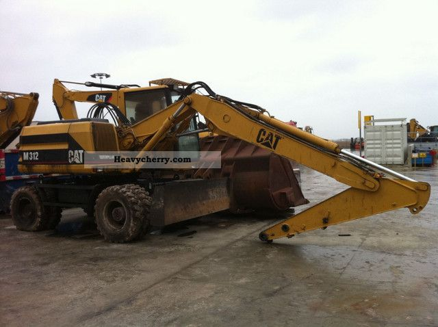 1996 CAT  M312 * Year 1996/10000 h / VA / Hammerltg / shield * Construction machine Mobile digger photo