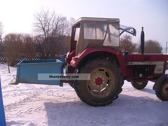 1974 IHC  554-S with rear and rear loader containers Agricultural vehicle Tractor photo