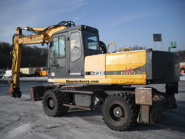 2000 Furukawa  W 738 LS-tronic claws Schlild-Verstellauslege Construction machine Mobile digger photo