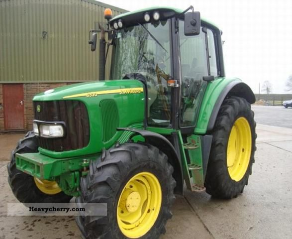 2002 John Deere  6320 Agricultural vehicle Tractor photo