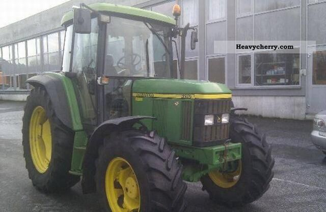 1999 John Deere  6210 Agricultural vehicle Tractor photo