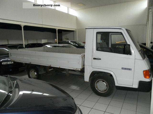 mercedes benz mb 100 flatbed tkm 1995 stake body truck photo and specs. Black Bedroom Furniture Sets. Home Design Ideas