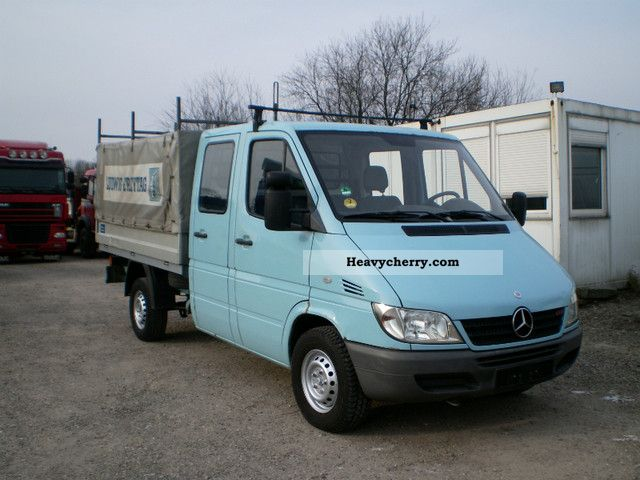 2003 Mercedes-Benz  311 CDI DoKa platform - Euro4 Van or truck up to 7.5t Stake body and tarpaulin photo