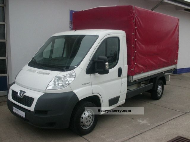2009 Peugeot  Boxer 335 Platform 2.2 HDi L2 Van or truck up to 7.5t Stake body and tarpaulin photo