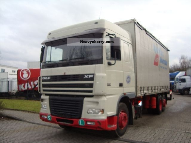 2003 DAF  XF95.380 flatbed tarp with PK23002 crane scarf Truck over 7.5t Stake body and tarpaulin photo