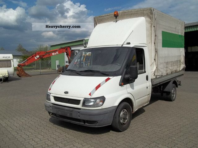 2002 Ford  Transit Van or truck up to 7.5t Stake body and tarpaulin photo