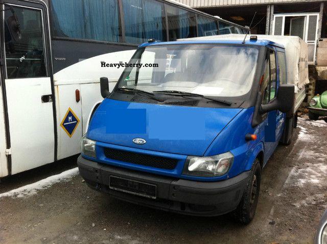 2003 Ford  Transit 125T330 DOKA / Flatbed / tarpaulin / EURO 4 Van or truck up to 7.5t Stake body and tarpaulin photo