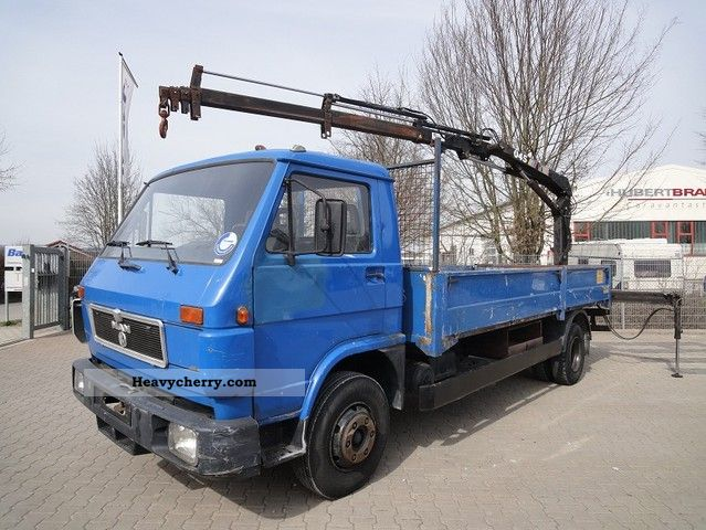 1992 MAN  8150 Flatbed with crane, original 136,279 km Van or truck up to 7.5t Stake body photo