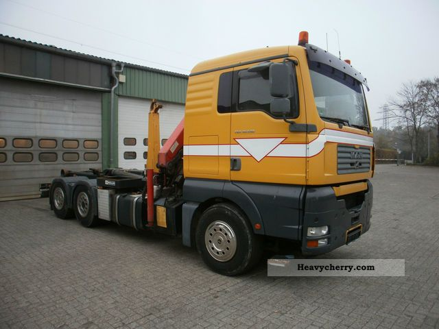 2003 MAN  TG-A / 36 530 € 4 DFL 6x4 with crane Truck over 7.5t Roll-off tipper photo
