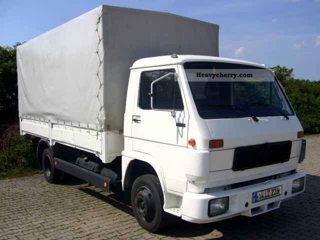 1992 MAN  G90 8150 Van or truck up to 7.5t Stake body and tarpaulin photo