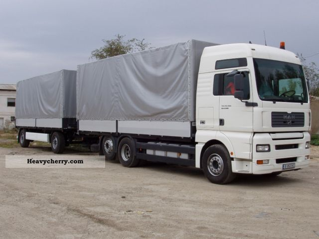 2005 MAN  TGA 26.463 Truck over 7.5t Stake body and tarpaulin photo