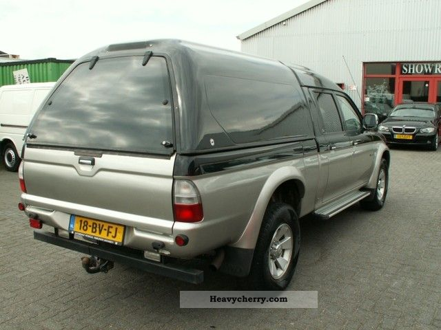 mitsubishi l200 pick up 4x4 truck long 2005 stake body truck photo and specs. Black Bedroom Furniture Sets. Home Design Ideas