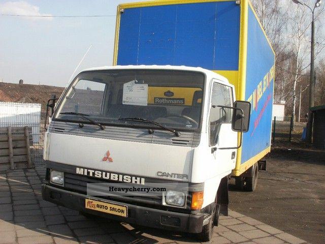 Mitsubishi Canter 1995 Stake body and tarpaulin Truck Photo