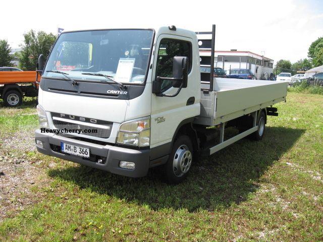 2010 Mitsubishi  FUSO FUSO Canter 7C15 Platform Van or truck up to 7.5t Stake body photo