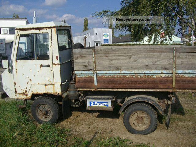 1975 Multicar  m 24 Van or truck up to 7.5t Three-sided Tipper photo