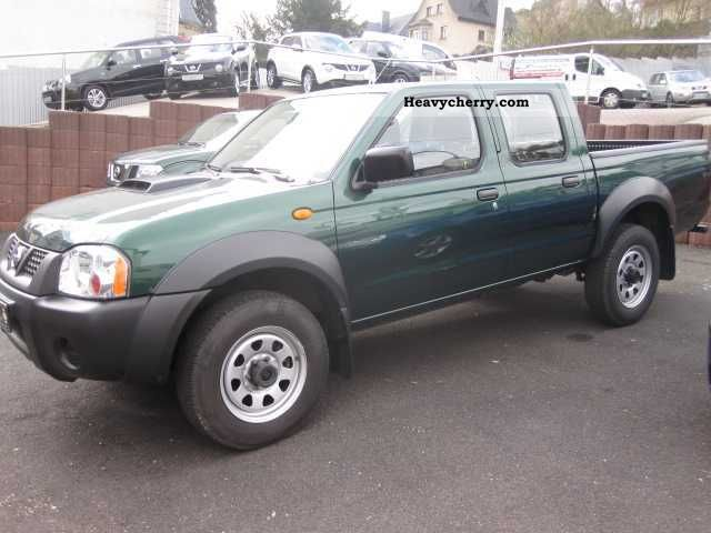 nissan np300 double cab 4wd pick up 2009 stake body truck photo and specs. Black Bedroom Furniture Sets. Home Design Ideas