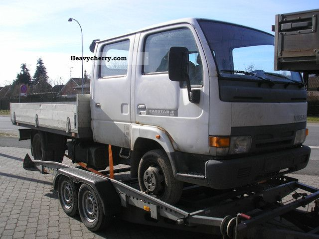 Nissan Capstar 3.0 D 110 2000 Stake body Truck Photo and Specs