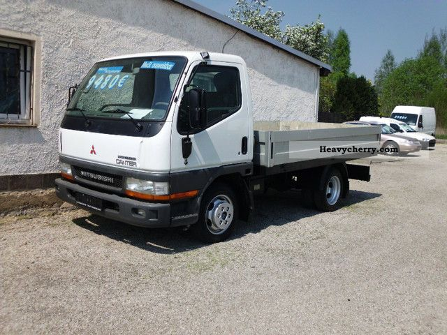 2003 Mitsubishi  Canter Platform Van or truck up to 7.5t Stake body photo