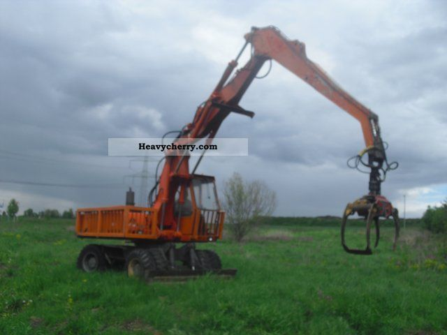 2011 Atlas  1604 excavator with wood / scrap grapple Construction machine Mobile digger photo